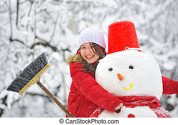 snowman and young girl