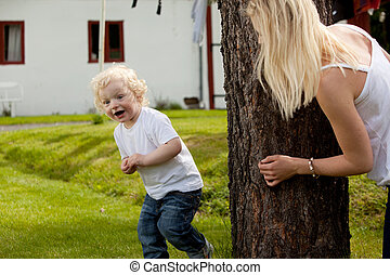 Young Boy Playing Hide and Seek