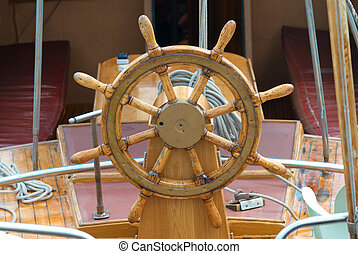 Old boat steering wheel - Old wooden steering wheel on the...