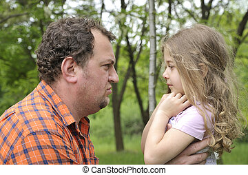 father attempting to discipline his daughter