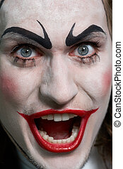 Tragic - Close-up of expressive male face with theatrical...