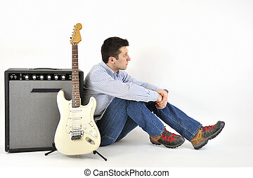 Boy with guitar and an amp