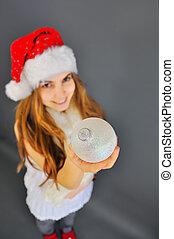 girl with a christmas ball