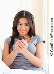 amazed woman looking at mobile phone