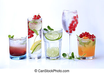 Summer drinks - Iced drinks garnished with fresh fruit -...