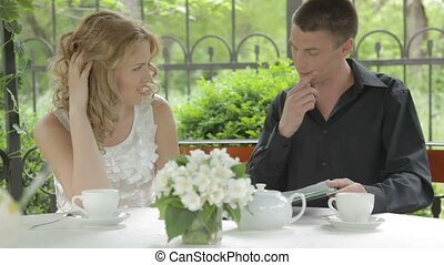Romantic young couple sitting outdo - EDIT 2 CAMS Young...