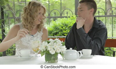 Young romantic couple eating desser