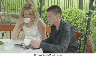 Beautiful young couple drinking tea