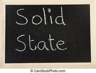 Board with SOLID STATE - A black board with a wooden frame...