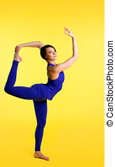 woman stand with yoga sign - blue on yellow
