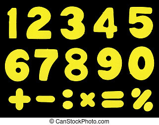 Numbers and mathematic operations simbols made of yellow color sponge-alike soft plastic, isolated on black background