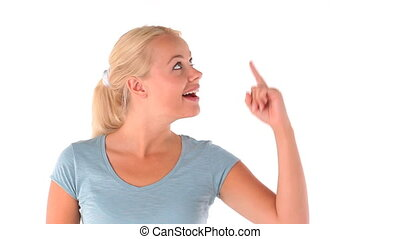 Blonde-haired woman pointing her finger against a white...