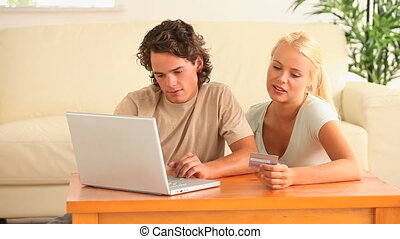 Couple buying online in the living room
