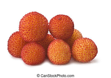 Pile of ripe arbutus. - Fresh arbutus fruits isolated over a...