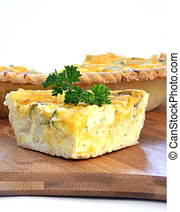 Quiche - Freshly prepared slice of quiche with parsley