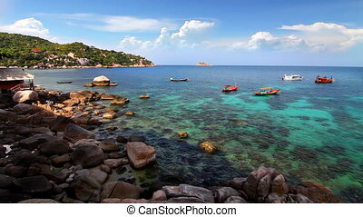 Rocky shore and boats loop