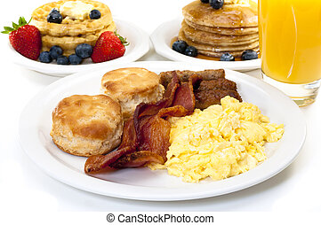 Big Breakfast - Breakfast plate with scrambled eggs, bacon,...