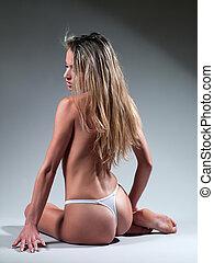 Beautiful woman in mini bikini