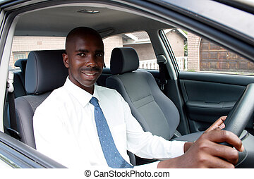 african businessman driving  a car