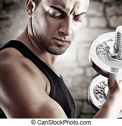 Young man in shape - Young man doing weights lifting on...
