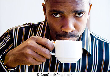 african man drinking coffee