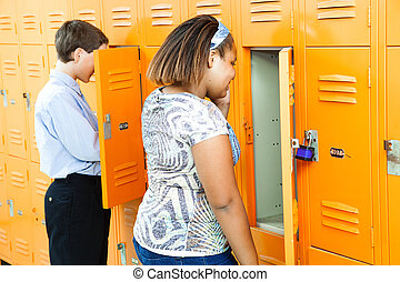Middle School Students at Lockers - Middle school girl and...