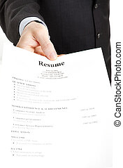 Job Search - Resume - Closeup of a businessmans hand holding...