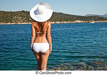 young woman in white bikini - Young woman in white bikini...