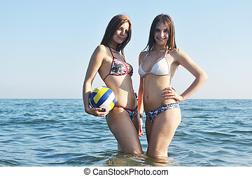 two girls posing in sea - two hot girls posing in bikini...