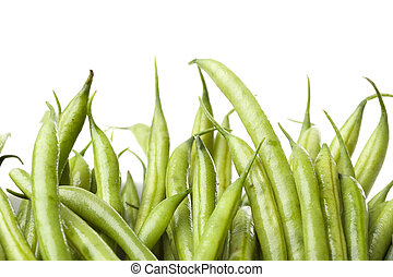 A fresh green string bean against a white background
