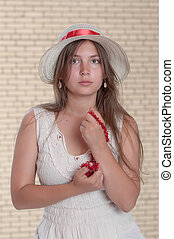 The girl with a coral beads