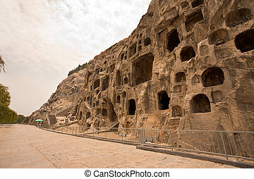 Carvings Caves Longmen Grottoes - Ancient Buddhist carvings...