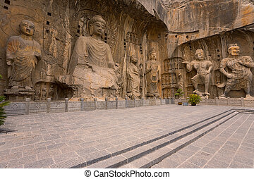 Longmen Grottoes Chiseled Statues - Intricately carved...
