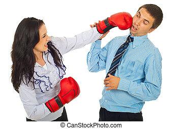 Furious business woman kicking man
