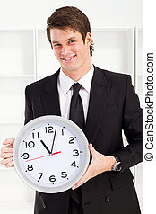 business time - businessman holding clock
