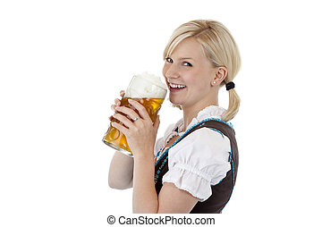 Attractive blond girl drinking out of oktoberfest beer stein