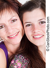 Mother and teen daughter portrait - middle aged mother and...
