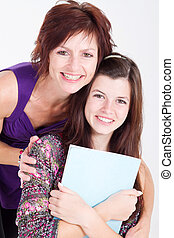 mother and teenager daughter - middle aged mother and...