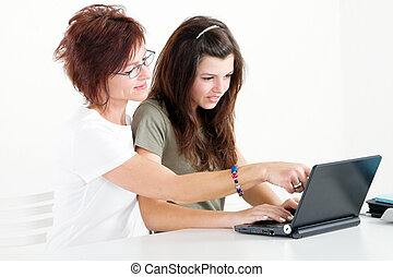 mom helping daughter studying - caring mom helping daughter...
