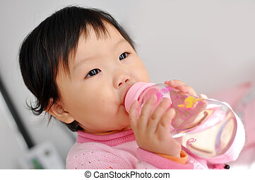 A Asian baby girl drinking water - A Asian baby Girls eat...