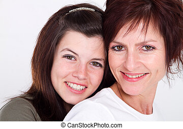 happy mother and daughter - middle aged mother and teen...