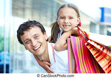 Shopping dad - Portrait of father with daughter and shopping...