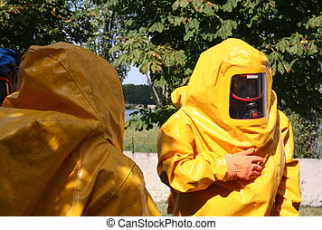 Man iin yellow chemical suit - man in yellow chemical suit...