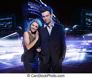 Young couple over the night city background
