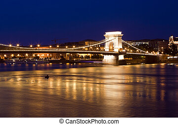 Budapest skyline, reflected on the river bridge at night. -...