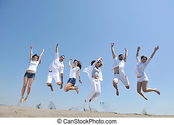 happy people group have fun and running on beach - happy...
