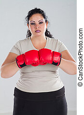 plus size woman with boxing gloves