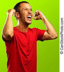 man shouting - man happy shouting against a green background
