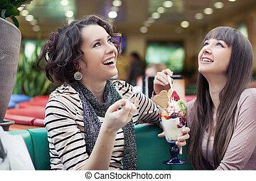 Two women enjoy a coffee break