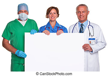 Medical team holding a blank poster isolated - Photo of a...